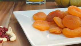 Dried fruits and nuts lying on the plate stock video footage