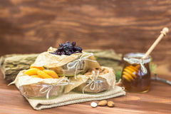Dried fruits and nuts organic healthy mix with honey on rustic background. Stock Photo