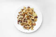Dried fruits nuts on a plate stock photo