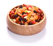 Dried fruits and nuts in plate over white Royalty Free Stock Photos