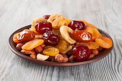 Dried Fruits and nuts in plate Royalty Free Stock Photos