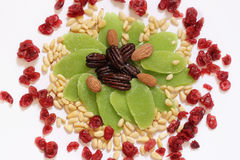 Dried fruits and nuts - symbols of judaic holiday Tu Bishvat. Mix of dried fruits, berries and nuts arranged as a flower or a sun stock photography