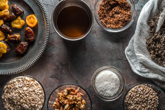 Dried fruits, nuts, syrup and cannabis seeds for the preparation of granola. Horizontal Stock Photo
