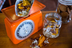 Dried fruits and nuts on weighing machine Royalty Free Stock Image