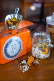 Dried fruits and nuts on weighing machine Stock Photography