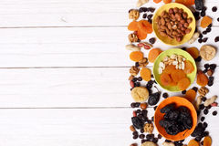 Dried fruits and nuts on white wooden background Royalty Free Stock Photos