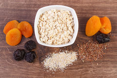 Dried fruits, oat bran, linseed and oatmeal in bowl, increase metabolism Royalty Free Stock Photography