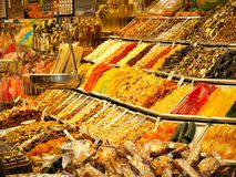 Dried fruits and other sweets on sale in La Boqueria market in Barcelona royalty free stock photography