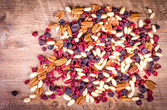 Dried fruits - pecan, cranberry, raisin, almond on wooden royalty free stock image