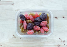 Dried fruits in plastic box Royalty Free Stock Images
