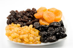 Dried fruits on a plate Stock Images