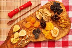 Dried fruits on tablecloth. Dried fruits on red tablecloth Royalty Free Stock Photos