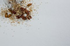 Dried fruits spilling out of bottle Royalty Free Stock Photos