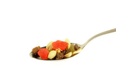 Dried fruits in the spoon isolated Stock Photography