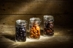 Dried fruits. Still life with dried fruits - apricots, prunes and dates Royalty Free Stock Photography