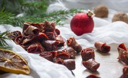 Dried fruits strawberry berries pasta candied fruits on a table under a glass cap christmas tree bumps nuts tissue nuts. Dried fruits strawberry berries pasta Royalty Free Stock Photography
