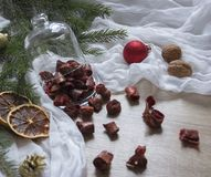 Dried fruits strawberry berries pasta candied fruits on a table under a glass cap christmas tree bumps nuts tissue nuts. Dried fruits strawberry berries pasta Stock Photos