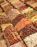 Dried fruits and sweets on display at a market stall Stock Photo