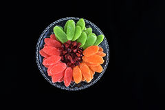 Dried fruits - symbols of Jweish holiday Tu Bishvat. Dried fruits served in plate and forming a flower shape - symbols of the Jewish holiday Tu Bishvat royalty free stock photo