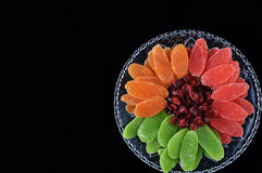 Dried fruits - symbols of Jweish holiday Tu Bishvat. Dried fruits served in plate and forming a flower shape - symbols of the Jewish holiday Tu Bishvat stock photography