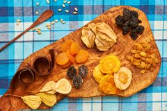 Dried fruits on tablecloth. Dried fruits on blue tablecloth Stock Photo