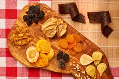 Dried fruits on tablecloth. Dried fruits on red tablecloth Royalty Free Stock Image