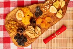 Dried fruits on tablecloth. Dried fruits on red tablecloth Stock Photo