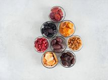 Dried fruits. Various Dried fruit in glass bowls on a gray background Royalty Free Stock Photo