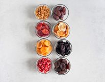 Dried fruits. Various Dried fruit in glass bowls on a gray background Stock Photography