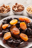 Dried fruits in a white plate with nuts Royalty Free Stock Image