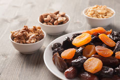 Dried fruits in a white plate with nuts Royalty Free Stock Images