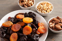 Dried fruits in a white plate with nuts Royalty Free Stock Photo
