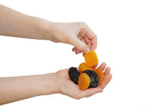 Dried fruits in women hands Stock Images
