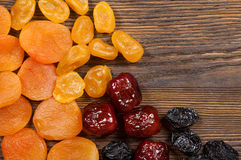 Dried fruits on a wooden background Stock Photography