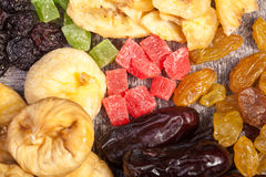 Dried fruits on wooden background in close up photo Stock Photos