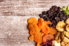 Dried fruits on wooden background in close up photo Stock Image