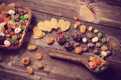 Dried fruits on wooden background Stock Images