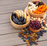 Dried fruits in wooden bowl Stock Images