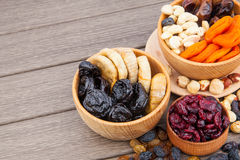 Dried fruits in wooden bowl Stock Photos