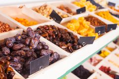 Dried fruits in wooden containers on a rack royalty free stock photography