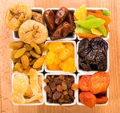 Dried fruits on wooden table Royalty Free Stock Photo
