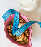 Dried Fruits, yogurt and centimeter for dieting Royalty Free Stock Photography