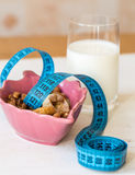 Dried Fruits, yogurt and centimeter for dieting Royalty Free Stock Images