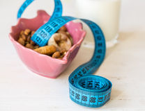 Dried Fruits, yogurt and centimeter for dieting Stock Images