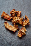 Dried Galangal Root in Close Up on Dark Stone Royalty Free Stock Photo