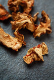 Dried Galangal Root in Close Up on Dark Stone Royalty Free Stock Images