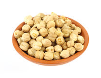 Dried garbanzo beans in small bowl Stock Image