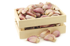 Dried garlic cloves in a wooden box Royalty Free Stock Photography