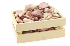 Dried garlic cloves in a wooden box Stock Photos