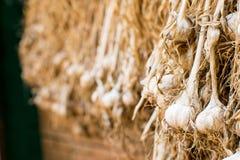 Dried garlic stem Hang on the railing. royalty free stock photos